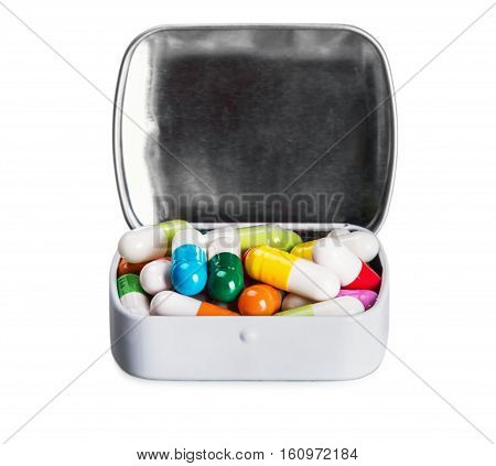 many different colored pills isolated on white background