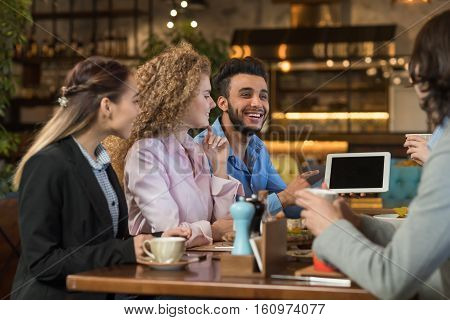 Young Business People Group Drink Coffee Cafe, Guy Show Tablet Computer, Friends Smiling Mix Race Men Women Talking