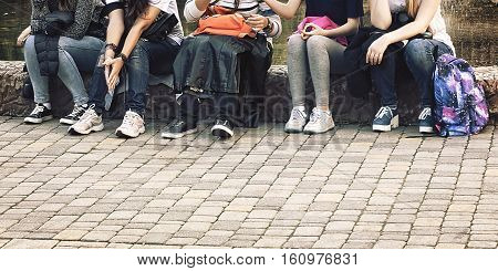 hipsters girls sitting in the park by the fountain