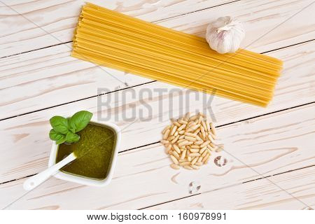 Pesto genovese and linguine pasta pine nuts and garlic seen from above