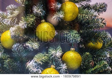 Showcase in the mall. Christmas festive bright background with huge Christmas Tree with Christmas balls decorations.
