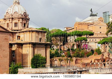 Rome, Italy. Ancient ruins of the Forum and the monument to Victor Emmanuel II
