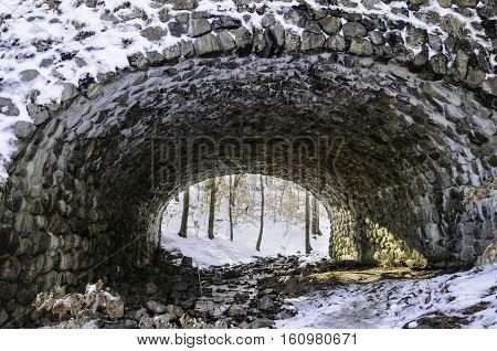 Stone bridge in Connecticut with culvert for stream