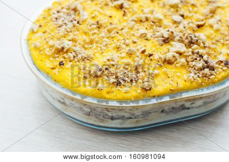 Salad Mimosa Layers On Top Of The Yolk And Walnuts, Close Up, Top View