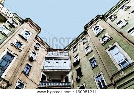View From The Bottom Up At The Sky, Tall Old Houses, Wells, Balconies