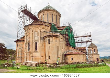 KUTAISI, GEORGIA - SEP 22, 2016: Medieval monastic complex Gelati in scaffolding during renovation on September 22, 2016. Gelati monastery was built in 12th century UNESCO World Heritage Site.