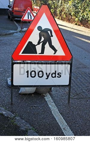 Warning sign for approaching roadworks road narrows