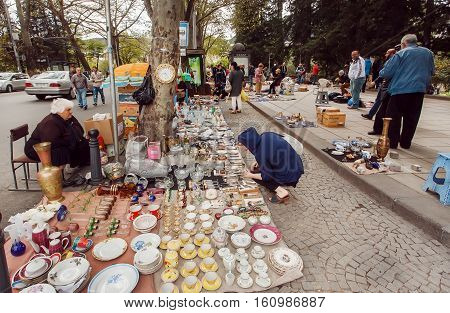 TBILISI, GEORGIA - SEP 24, 2016: Customers of the flea market Dry Bridge buying old kitchen utensils and retro souvenirs on September 24, 2016. Tbilisi has a population of 1.5 million people