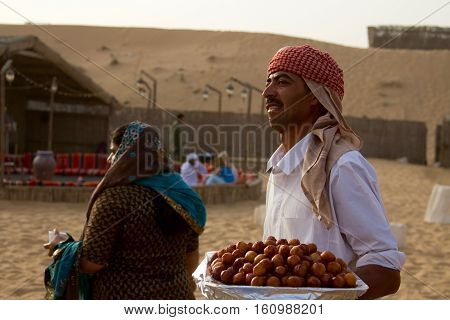 DUBAI, UAE - APRIL 20 2012: Staff at a desert safari camp prepares food in preparation for tourists arriving after dune bashing