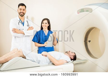 Couple Of Doctors Using A Cat Scanner