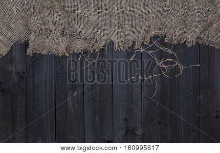 Burlap hessian or sacking on wooden background