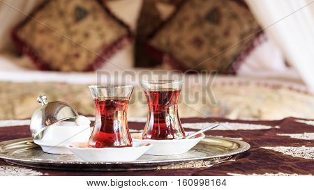 Two Turkish Tea Cups And Turkish Delight With Oriental Canopy Bed