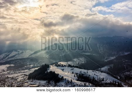 Stormy Weather Over Village In Mountains