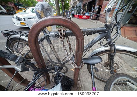 Chained bicycles parked on Manhattan NY USA