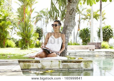 Attractive Young Pregnant Woman Wearing Stylish Sunglasses And Summer Dress Spending Spare Time In O