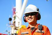 operator recording operation of oil and gas process at oil and rig plant, offshore oil and gas industry, offshore oil and rig in the sea, operator monitor production process, routine daily record. poster