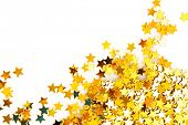 Golden stars in the form of confetti on white background poster