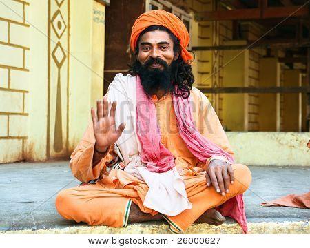 SOMNATH, INDIA -13 JANUARY: Spiritual Guru Shaiva sadhu (holy man) sitting in front of Somnath temple, January 13, 2008. Somnath, Gujarat, India