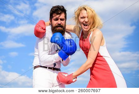 Attack is best defence. Relations family life as everyday struggle. Man and woman fight boxing gloves sky background. Couple in love fighting. Defend your opinion in confrontation. Female attack poster