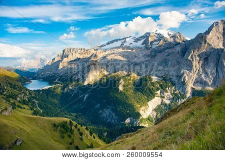 View To Marmolada And Fedaia Lake. Marmolada Is The Highest Mountain Of Dolomites, Situated In North