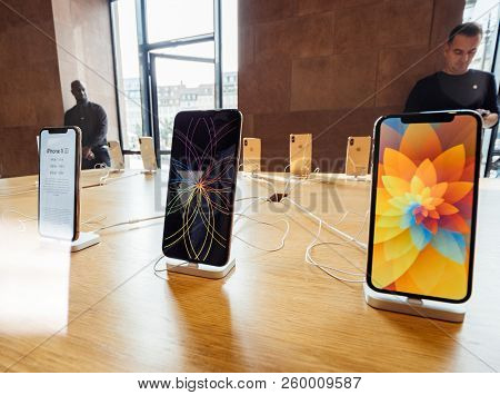 Strasbourg, France - Sep 21, 2018: Row Of New Iphones In Apple Store With Customers People Buying Ad