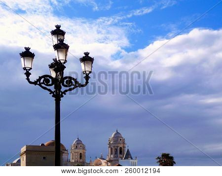 Lampposts At Sunset In The Bay Of Cadiz Capital. Andalusia. Spain