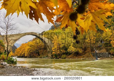 Old Stone Bridge In Konitsa And Aoos River An Autumn Day,epirus, Western Greece
