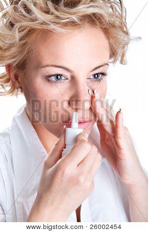 Woman  use an  bronchial inhale, studio shot
