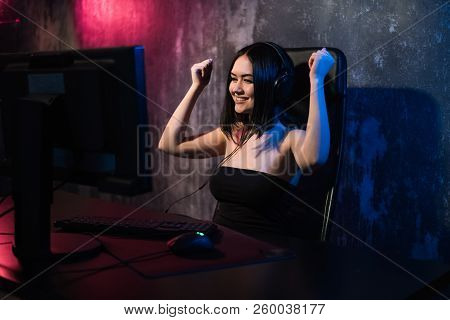 Portrait Of A Young Happy Girl Who Rejoices After Winning A Video Game, - Celebrating Winning In Gam