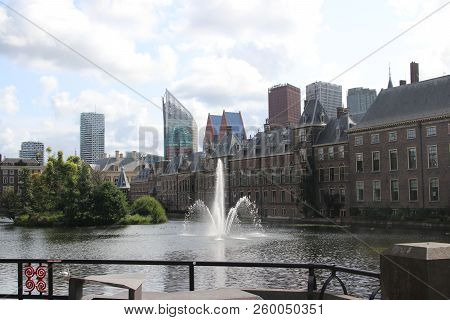 The Hofvijver Pool With Fountain Along The Parliament Building And The Skyline Of The Hague.