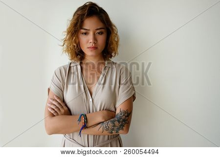 Sad Beautiful Girl Feeling Depressed. Young Asian Woman Staring Into Vacancy With Arms Crossed. Nega