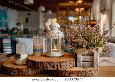Beautiful Stylish Autumn Table Decoration .white - Pink Heather In Autumn Basket.candles And Lamps.