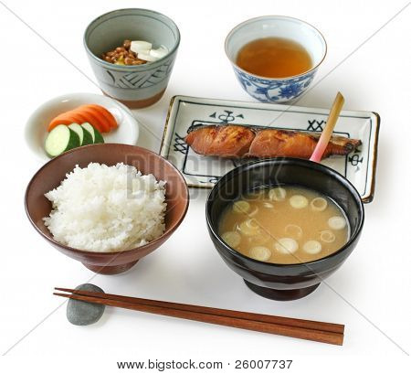 Traditional Japanese home cooking , Rice and grilled fish with miso soup and some pickles. poster