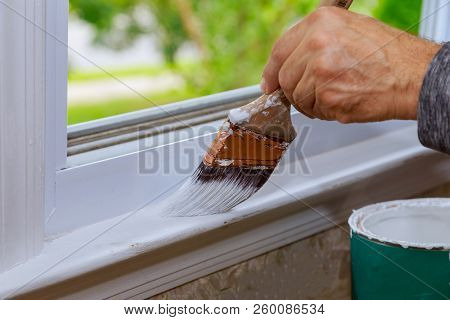 Painting A Wooden Window Paint With Paintbrush While Painting Window Trim