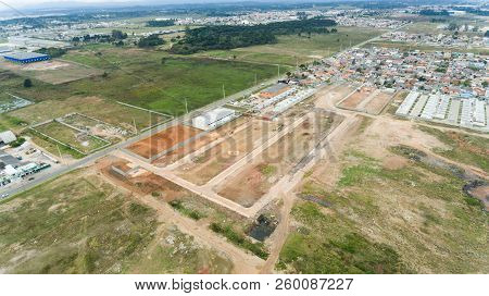 land ready for construction, virgin land, being prepared to be built a village, land made earthmovin