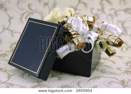 Open Blue And Gold Gift Box With Curly Ribbons