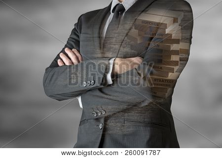 Unrecognizable Businessman Standing With His Arms Folded