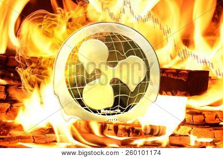 Ripple (xrp) Coin Buring In Bonfire, Cryptocurrency Price Value Going Down, Concept Photo.