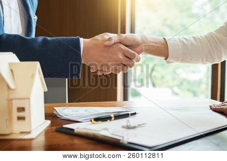 House Developers Agent Or Financial Advisor And Customers Shaking Hands After Signing Document Makin