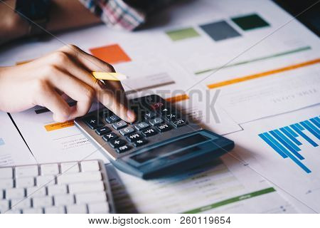 Businesswoman Analyzing Investment Charts With Calculator For Financial Data Analyzing Counting. Bus