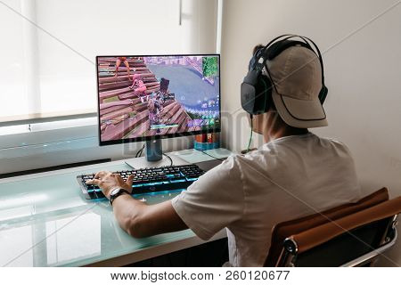 Madrid, Spain - August 15, 2018: Teenager Playing Fortnite Video Game On Pc. Fortnite Is An Online M
