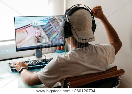 Madrid, Spain - August 15, 2018: Teenager Playing Fortnite Video Game On Pc. He Is Raising His Fist