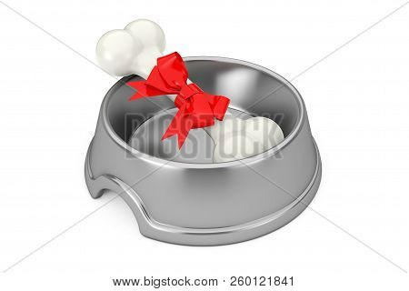 Present Dog Chew Bone Wrapped In Red Gift Ribbon In Stainless Steel Bowl For Dog On A White Backgrou