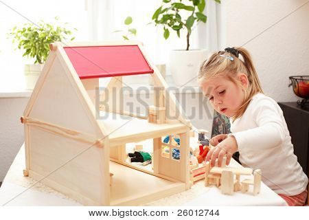Playing with doll's house