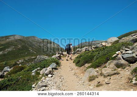 Hiker Walking On Besseggen Ridge In Jotunheimen National Park, Norway