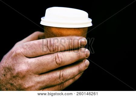 Small Coffee Cup In Man's Hand.