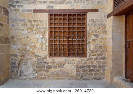 Mamluk Era Wooden Closed Window With Wooden Ornate Grid Over Stone Bricks Wall, Cairo, Egypt