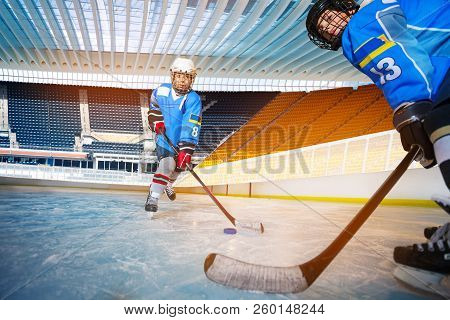 Boys Passing Puck During Hockey Training Session