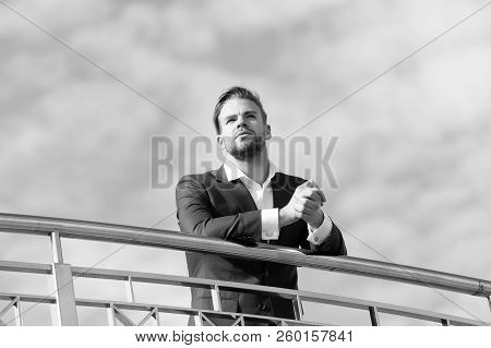 Man In Formal Wear Stand On Cloudy Blue Sky. Confident Businessman Outdoor. Looking To The Future. T