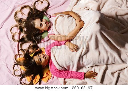 Schoolgirls In Pink Pajamas Wallow On Colorful Pillows, Topview
